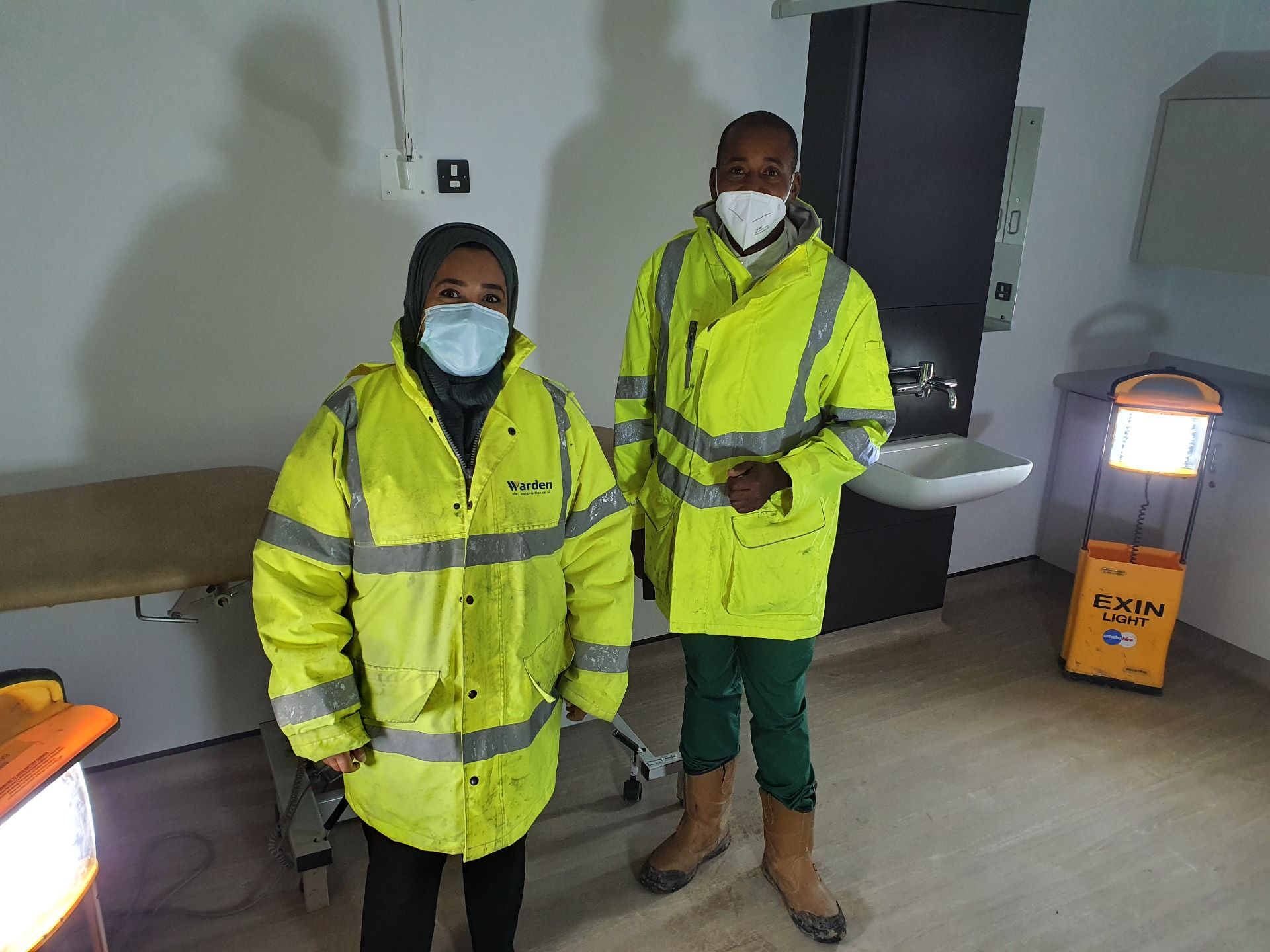 General Practitioners wearing high visibility jacket and face masks
