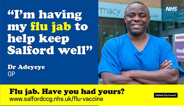 "Dr Adeyeye, GP on the cover of Salford fly jab campaign. He says ""I'm having my flu jab to keep Salford well""."