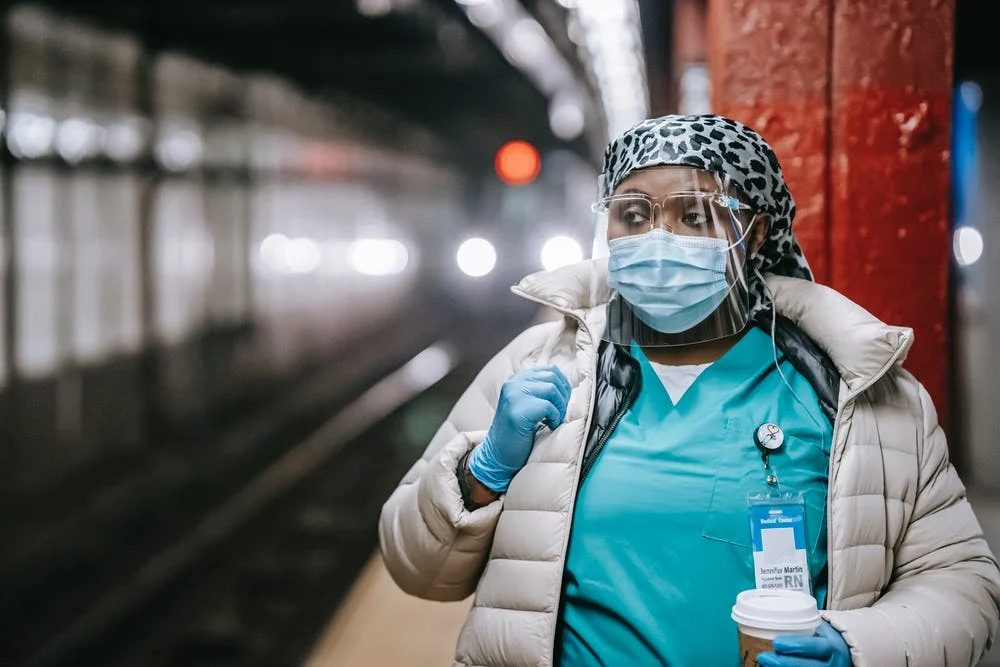 Nurse wearing face mask and sheild